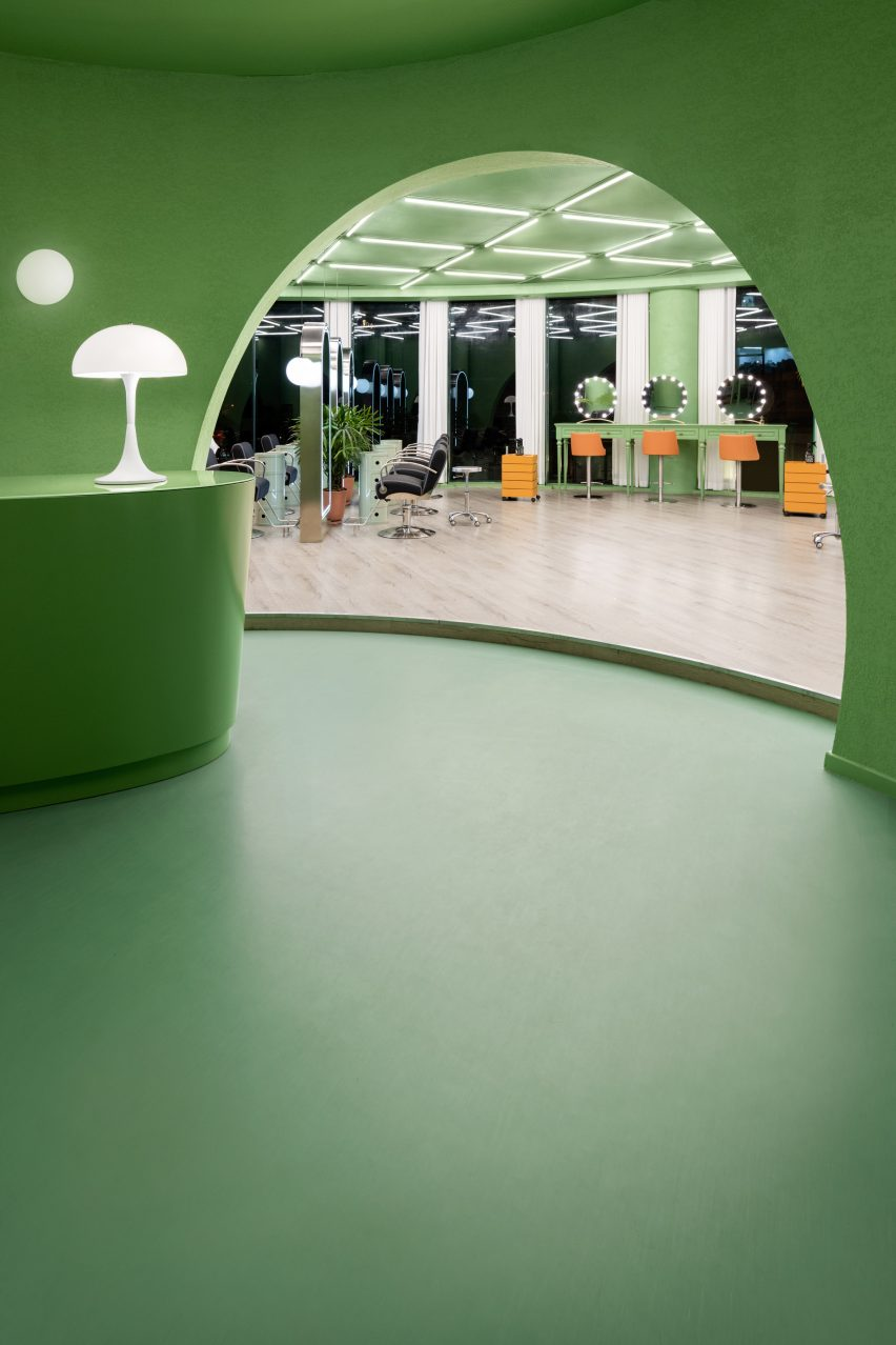 The lobby has a synthetic green floor by IS architecture and design