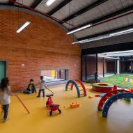 Arched roofs and colourful floors in the complex