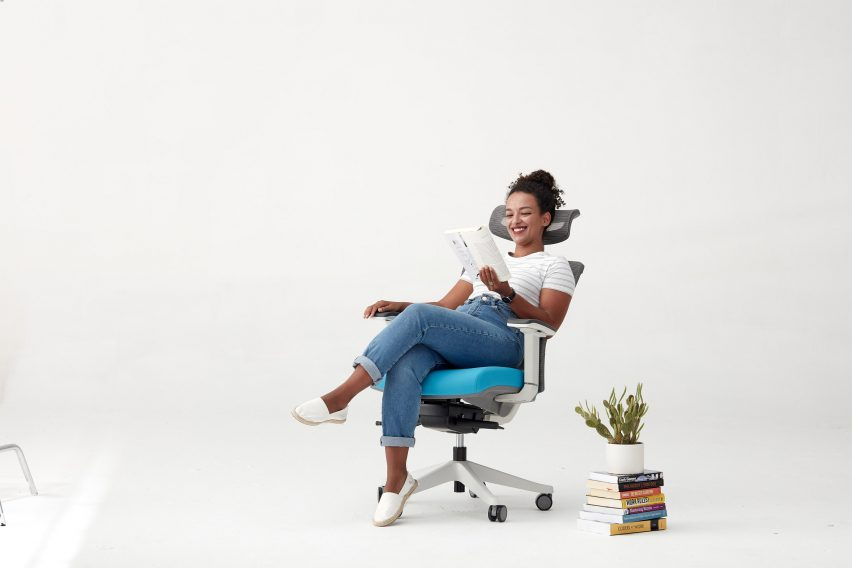 User relaxing in ergonomic office chair