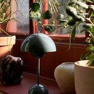 A windowsill with a Flowerpot table lamp by Verner Panton