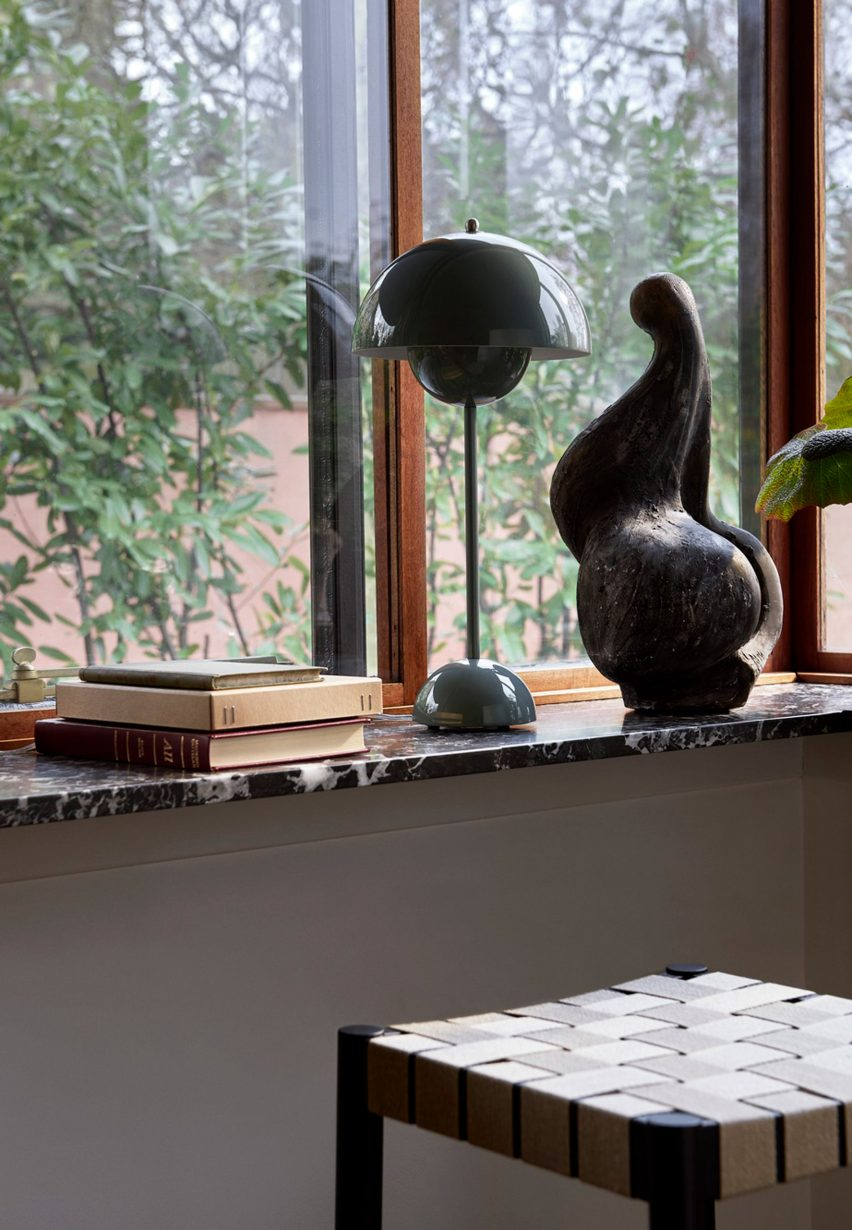 A windowsill with a Flowerpot lamp by &tradition