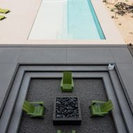 The fire pit next to the swimming pool