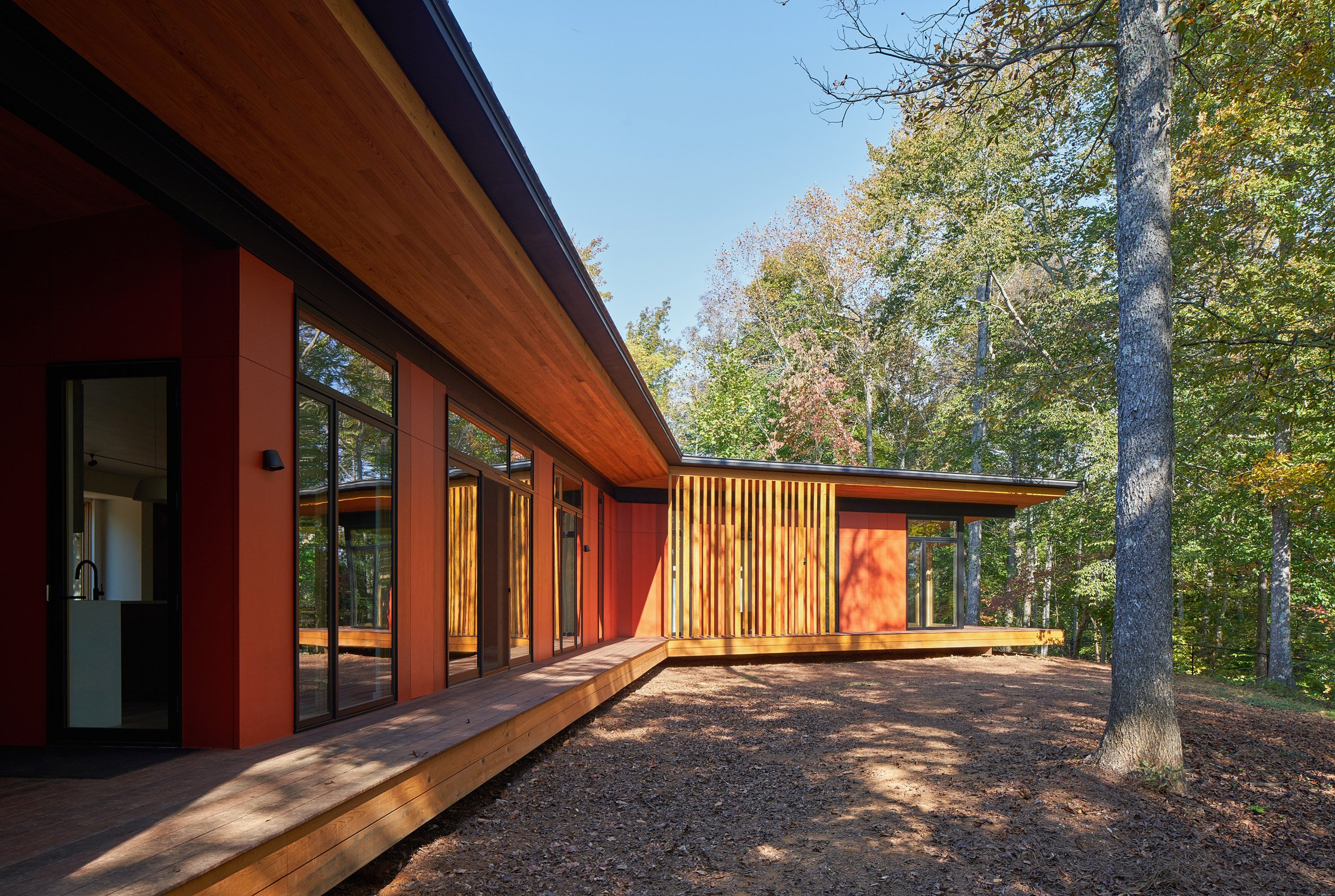 Stained cypress wood on exterior of house in the woods