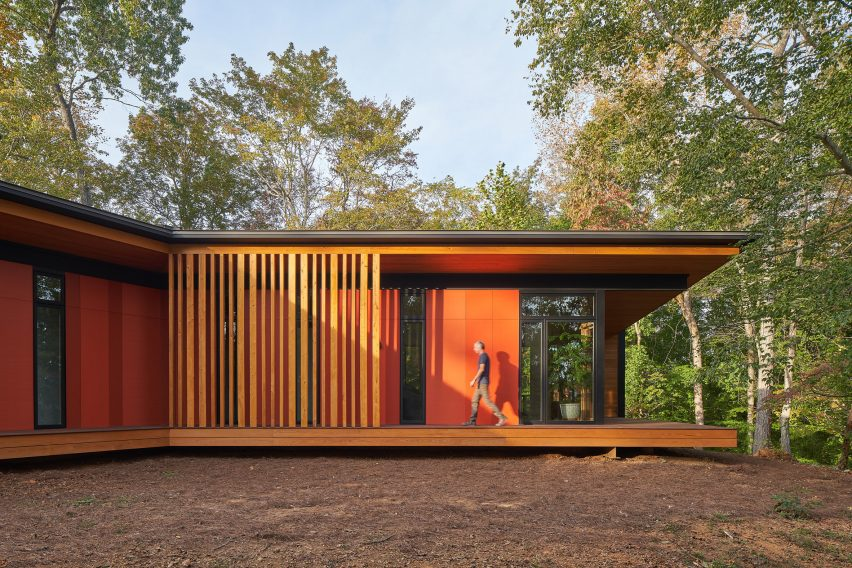 Orange siding of house by Sanders Pace