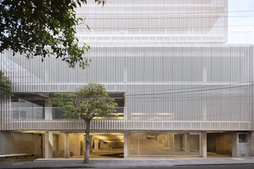 Perforated metal screen over a car park in Mexico
