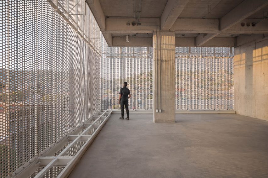 Concrete super structure and perforated metal facade