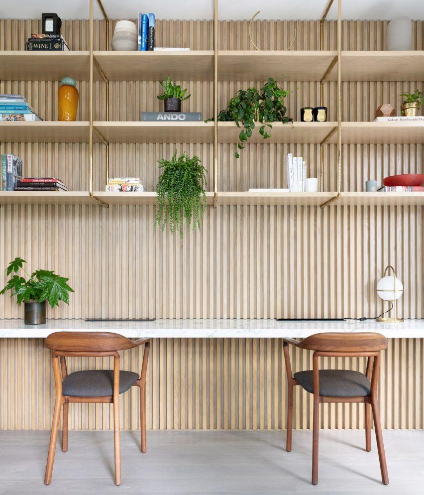 Home office with built-in shelving in Grosvenor Residence