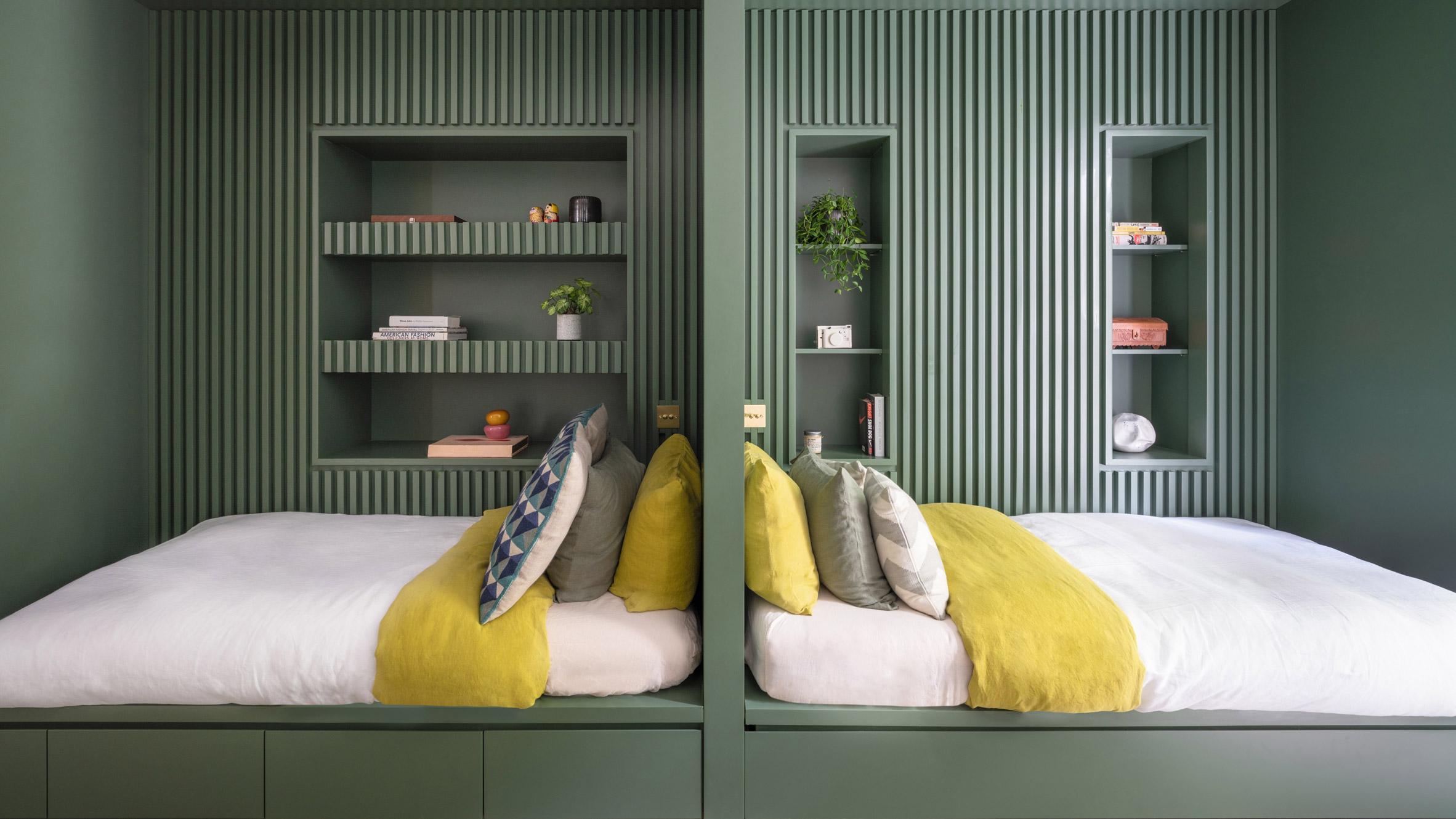 Kids bedroom with green cabin beds in Grosvenor Residence