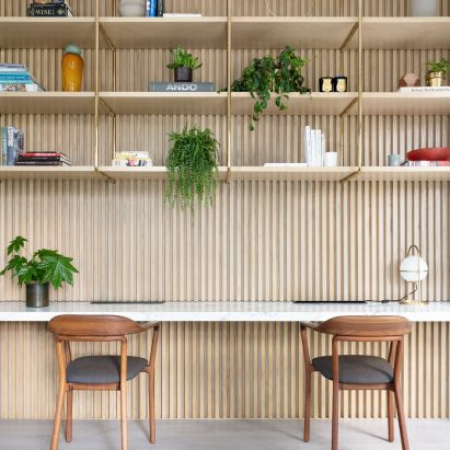 Home office with built-in shelving in Grosvenor Residence by Lim + Lu