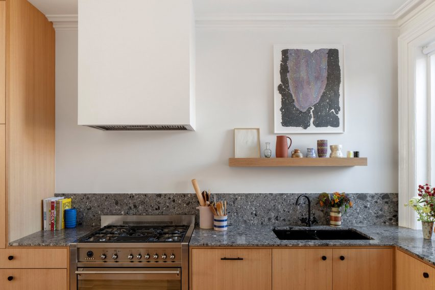 The kitchen features white oak cabinets