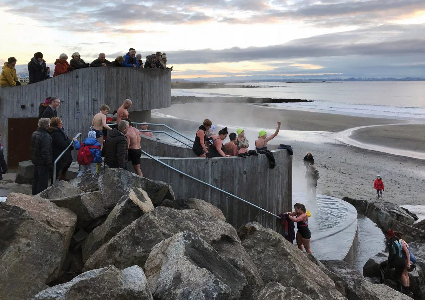 People at Guðlaug Baths by Basalt Architects