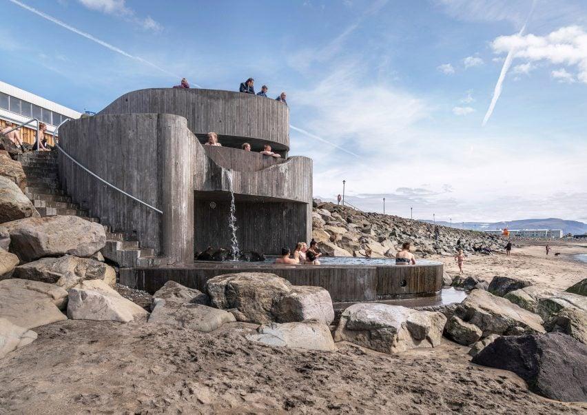 Beach view of Guðlaug Baths by Basalt Architects