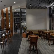 The restaurant includes dark vinyl floors
