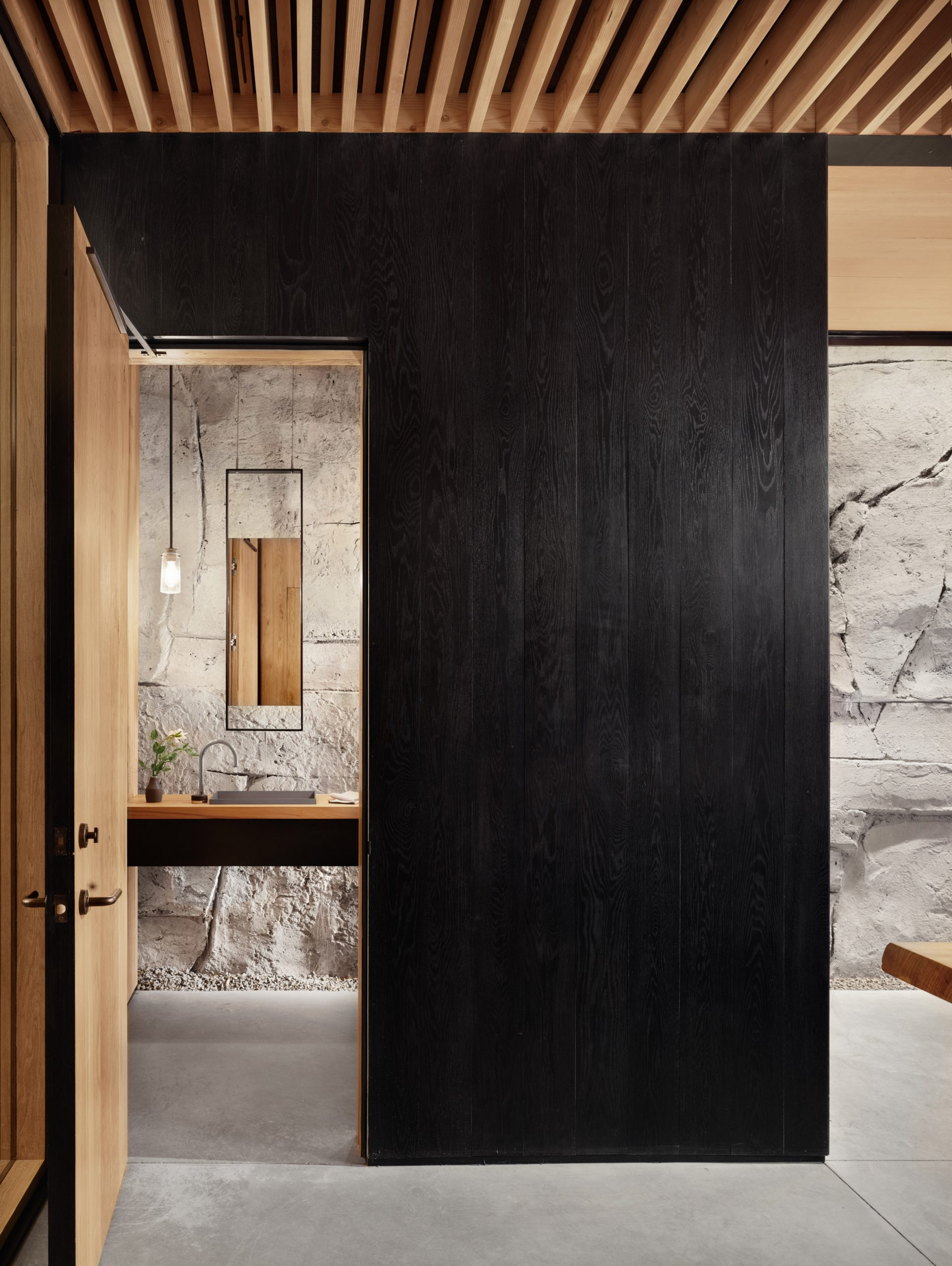 Ebonized wooden walls of Hill Country Wine Cave