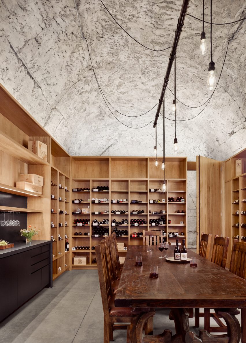 Wine cellar with vaulted concrete ceilings by Clayton Korte