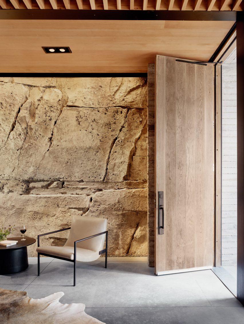 Sprayed concrete walls in Texas wine cellar by Clayton Korte