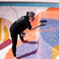 Alex Proba painting the swimming pool at Hill House