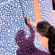 Alex Proba painting speckled details at Hill House