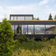 A rural holiday home clad in blackened timber