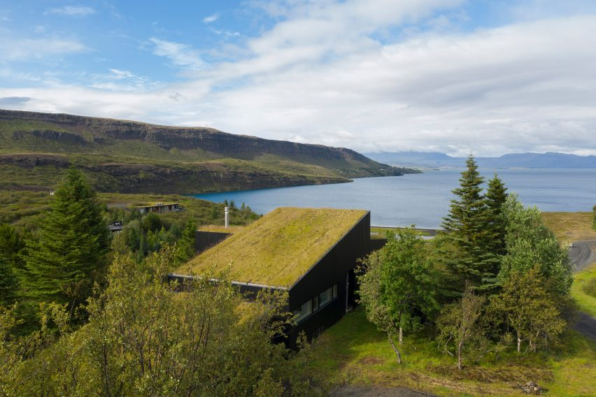 A house with a sloped green roof overlooking Lake Thingvallavatn