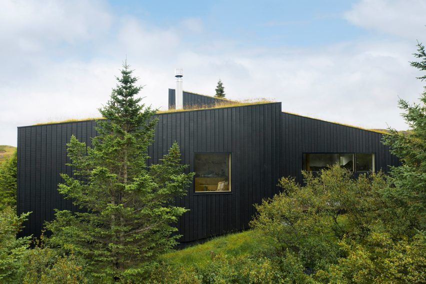 A holiday home with blackened-wood cladding