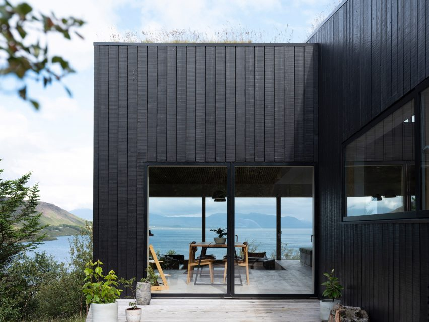 A blackened-wood holiday home overlooking Lake Thingvallavatn