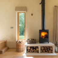 A cabin with a wood-burning stove