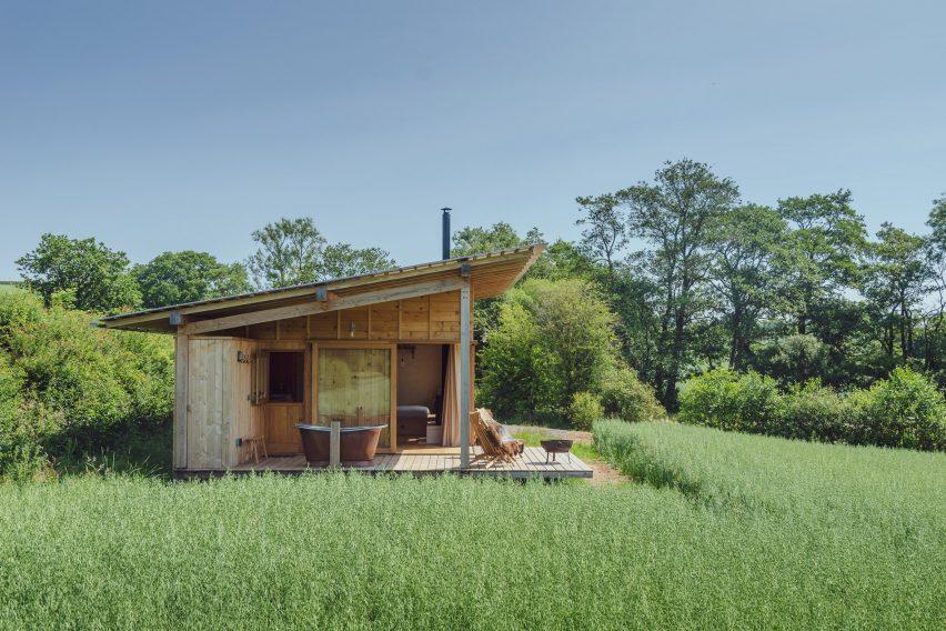 A cedar-clad cabin in English farmland