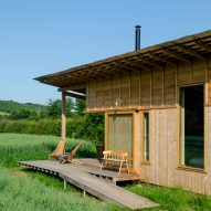 A wooden cabin with a sheltered veranda on a farm in England