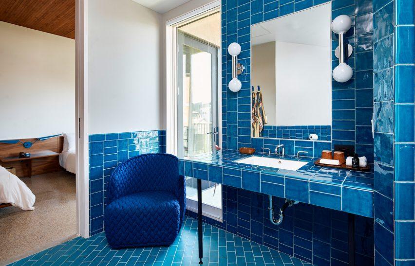 A blue tiled bathroom