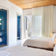 A blue tiled guest room
