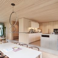 A wood-lined kitchen and dining room