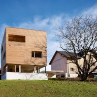 A timber-clad house in an Austrian village