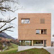 A square-shaped house clad in timber