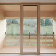 The view out of a wood-clad house by Firm Architekten