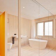 A spruce-lined bathroom in an Austrian house