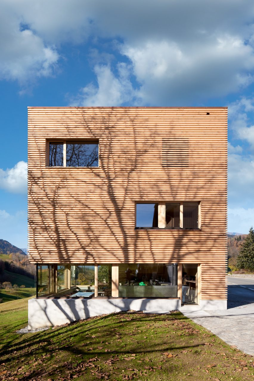 A timber-clad Austrian house with a concrete base