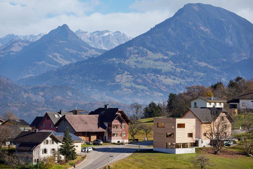 Austrian houses surrounded by Alpine landscape
