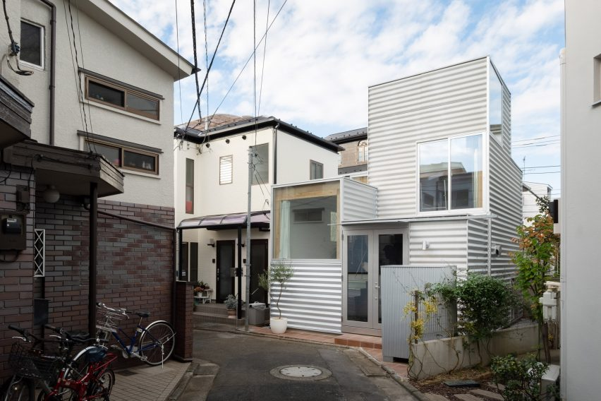 White building in Tokyo with large windows