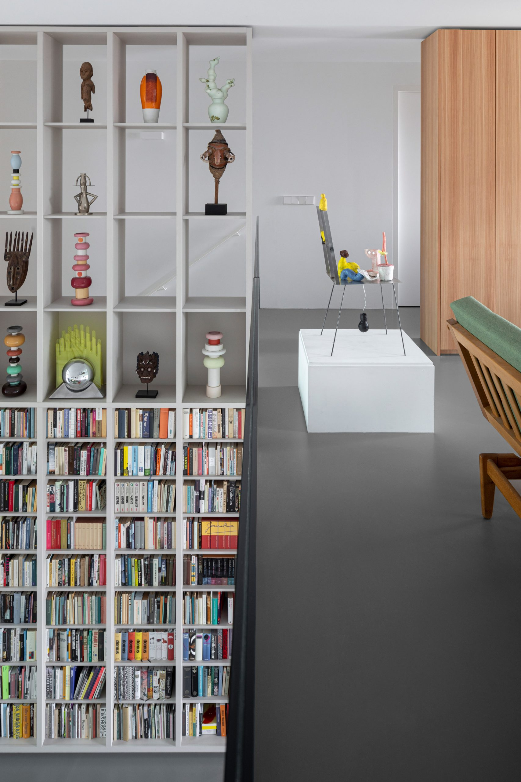 Open shelving displaying books and art in Amsterdam apartment