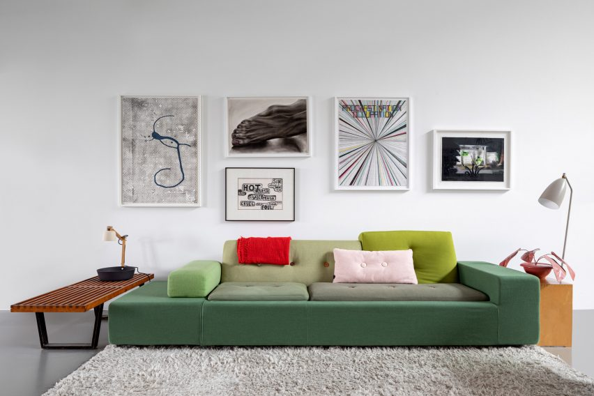 Green sofa with feature wall in Amsterdam apartment