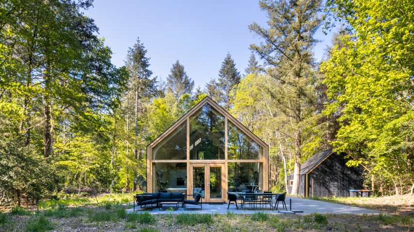A forest cabin with a glazed gable end