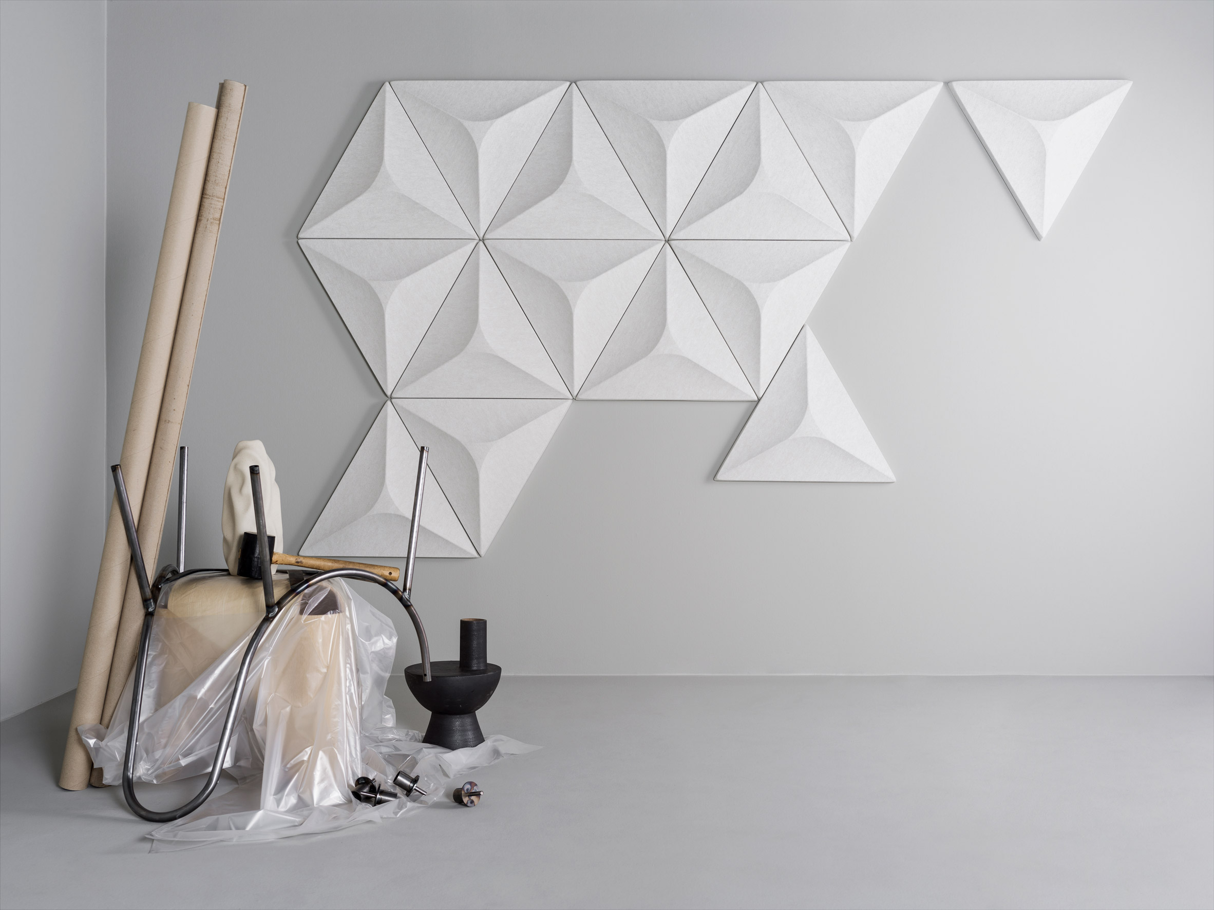 A group of white geometric acoustic panels