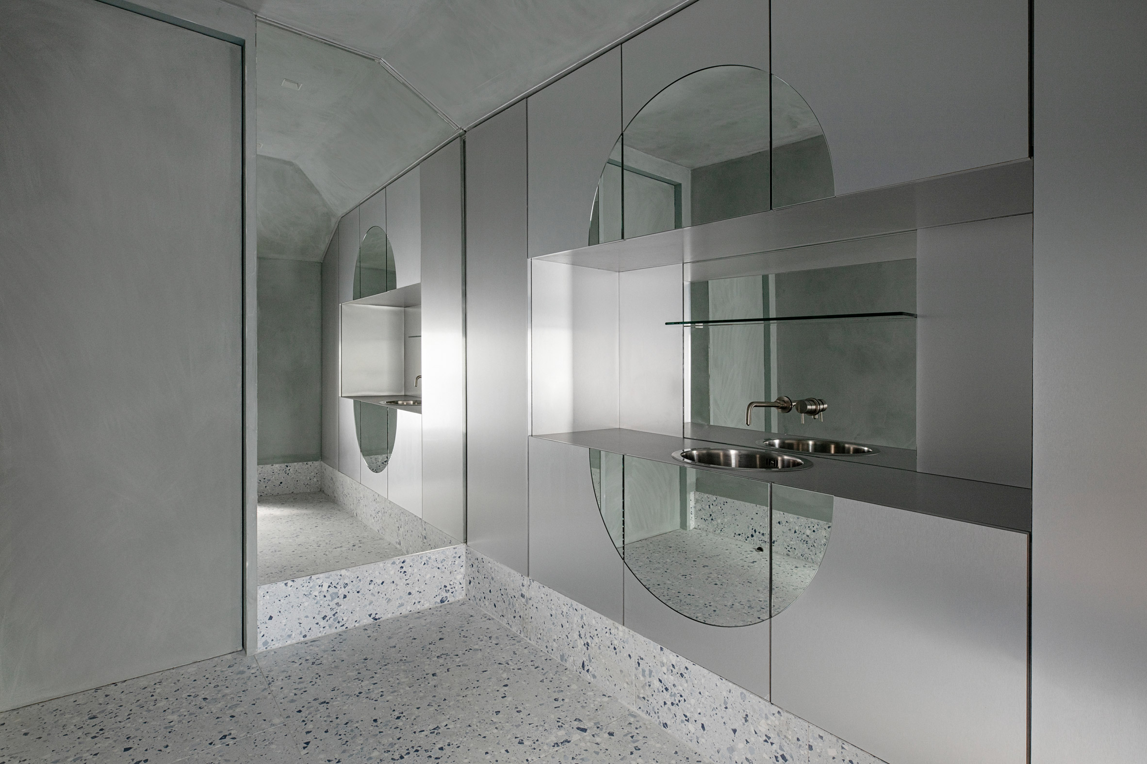 Stainless steel and terrazzo treatment room