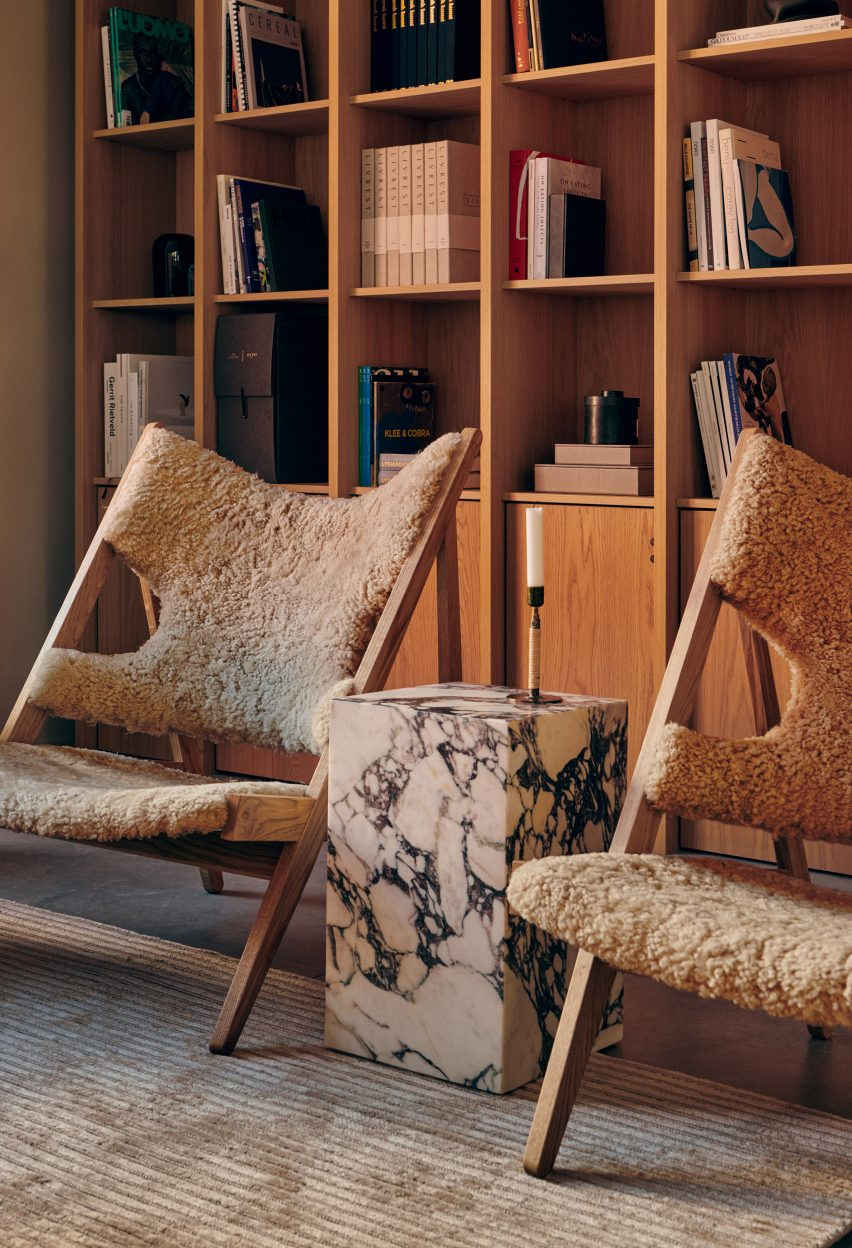 A pair of oak lounge chairs with sheepskin upholstery