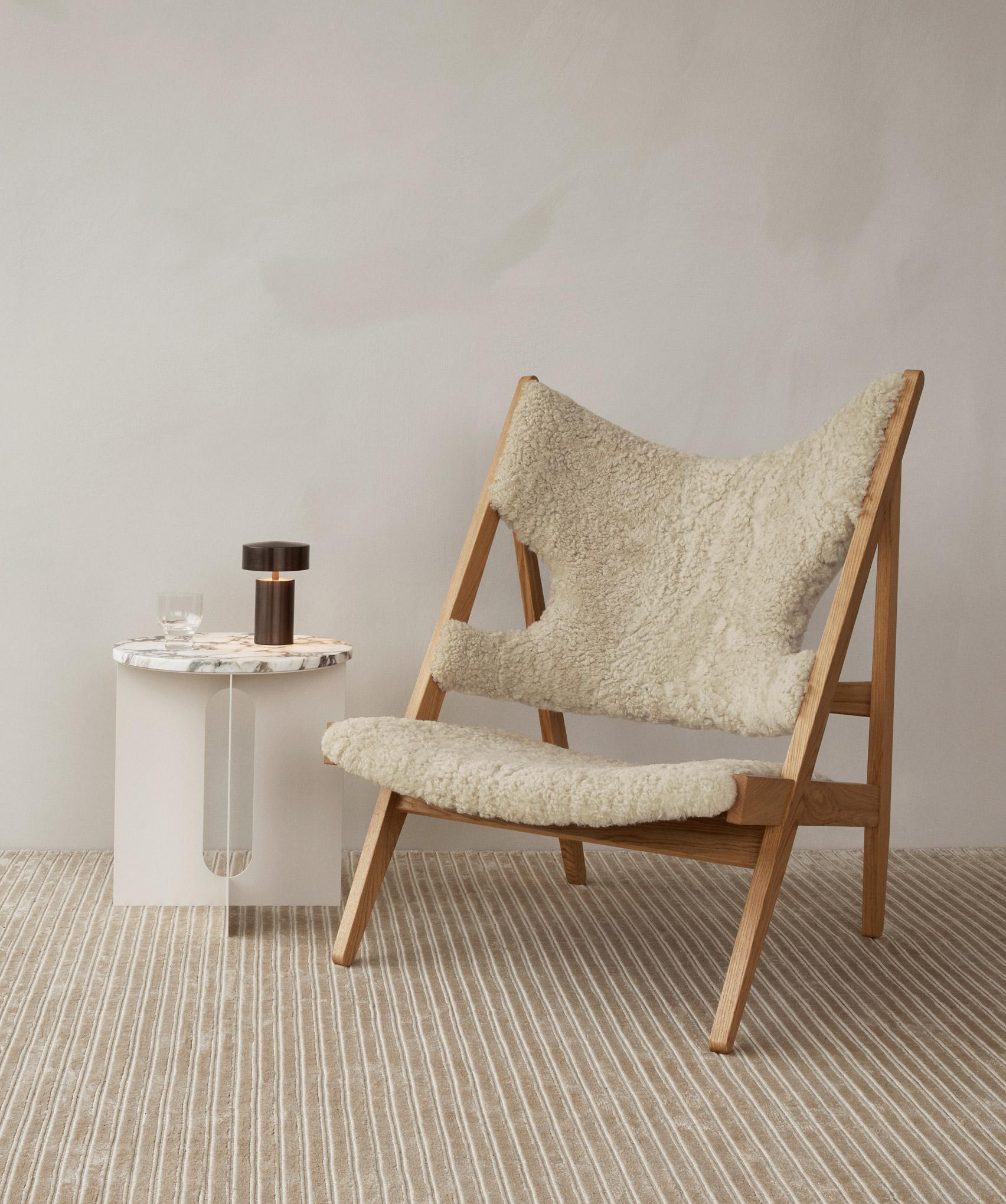 Lounge chair by Ib Kofod-Larsen with sheepskin upholstery