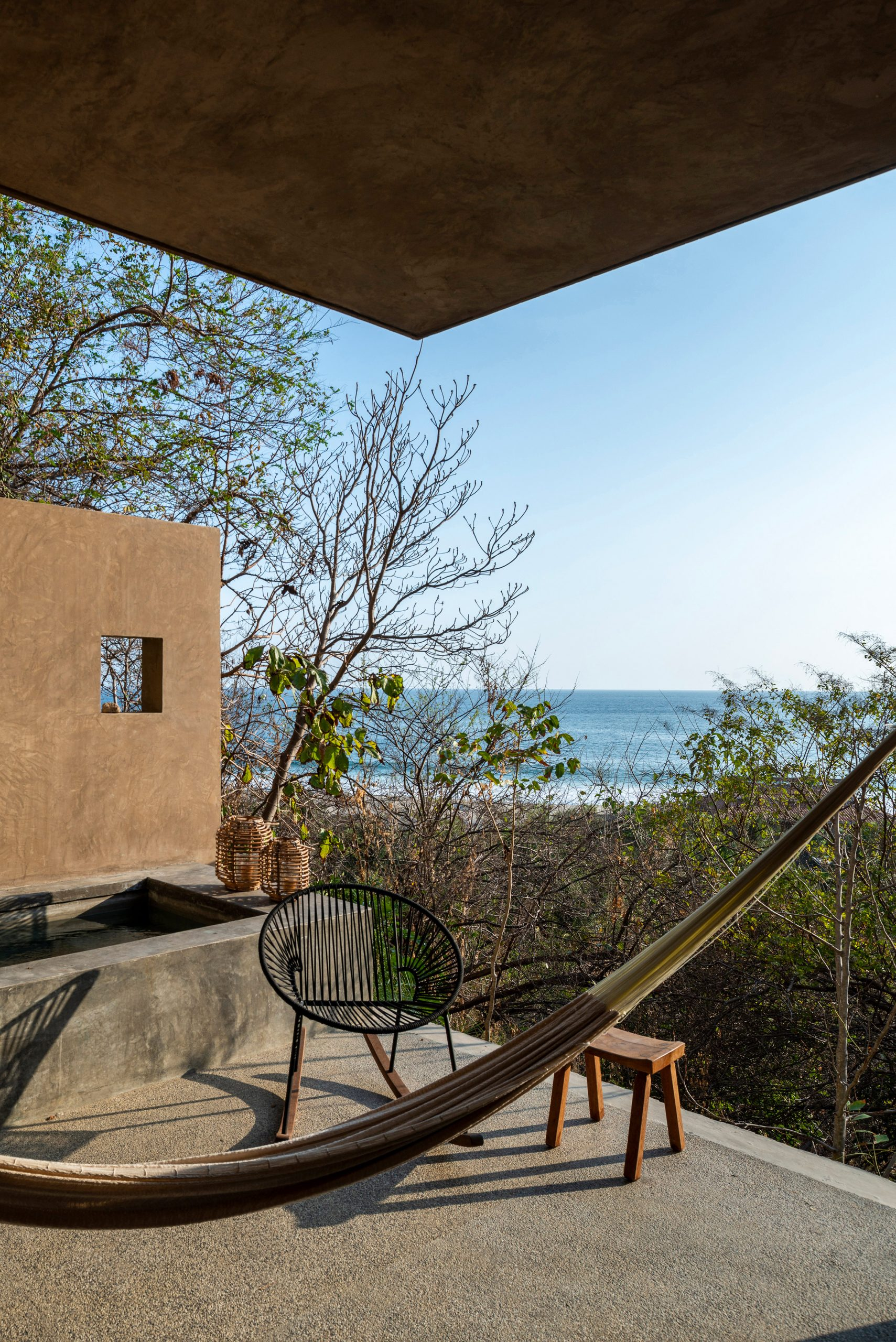 A terrace on the second volume by Em-Estudio