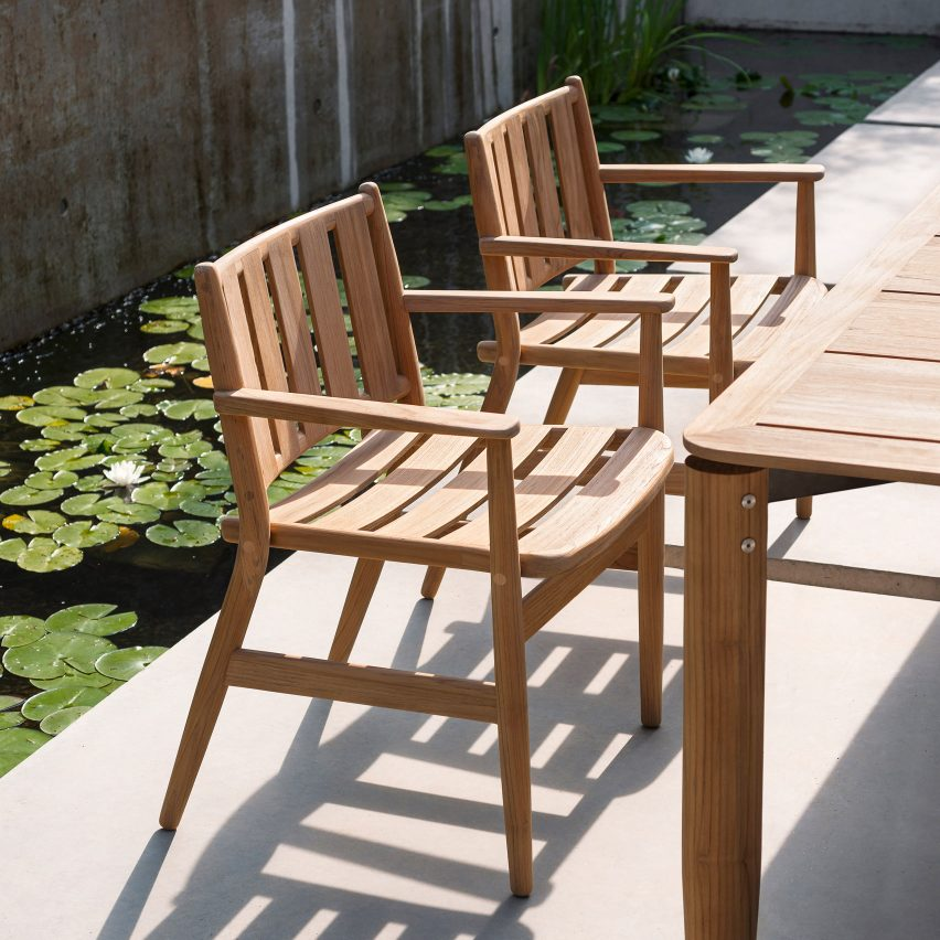 A pair of wooden outdoor dining chairs by Piero Lissoni
