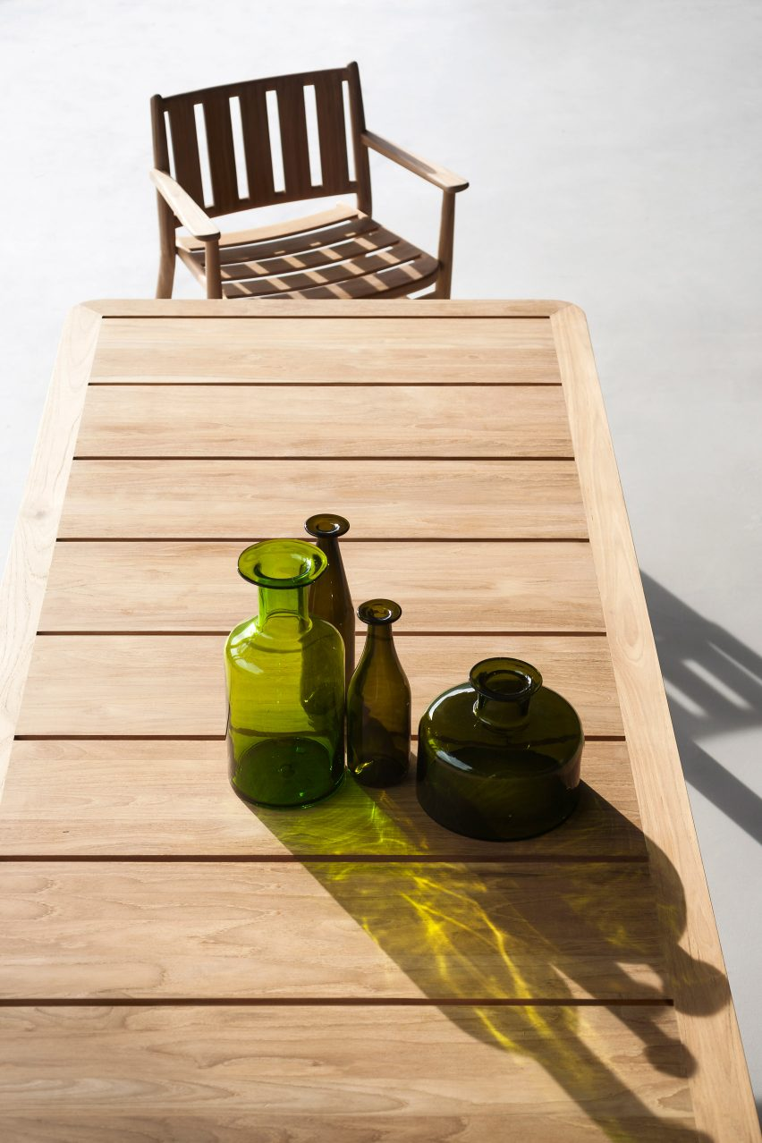 An outdoor dining table with a matching chair