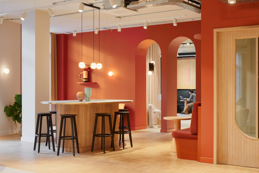 Terracotta walls and arched doorways in office